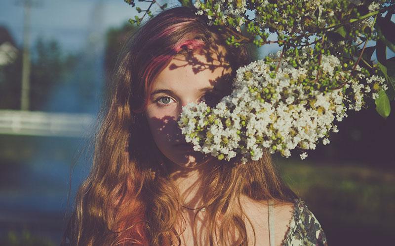 Behind the flower