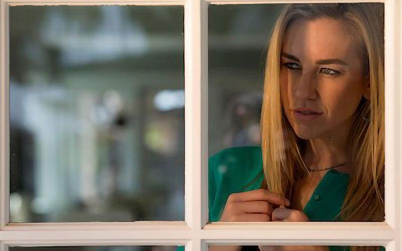 Portrait photo shot through a window
