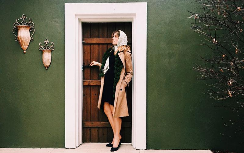woman standing by the door